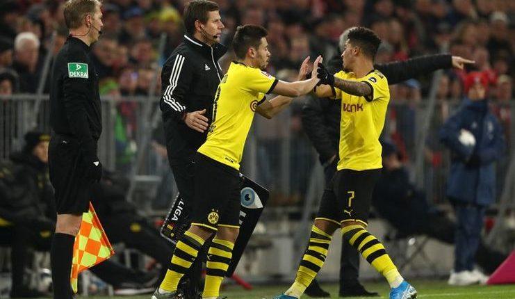"Jadon Sancho digantikan oleh Raphael Guerreiro pada menit ke-36 Bayern Munich v Borussia Dortmund. ""Class ="" wp-image-265066"